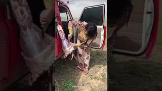 Woman Cutting Goat