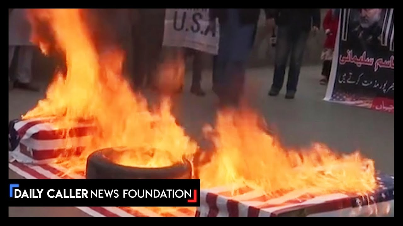 Iranian Protester Burn U.S. Flag Following Death Of Military Leader