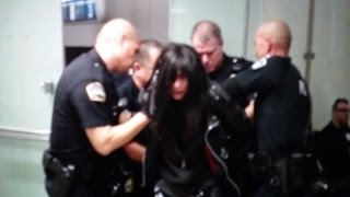 5150 woman out of control at LAX trying to walk in a do not enter area