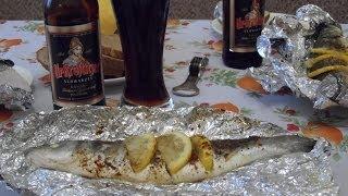 Сибас запеченный в фольге с лимонами в духовке. Рыба в фольге