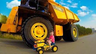 Senya helping daddy fix a broken tractor.