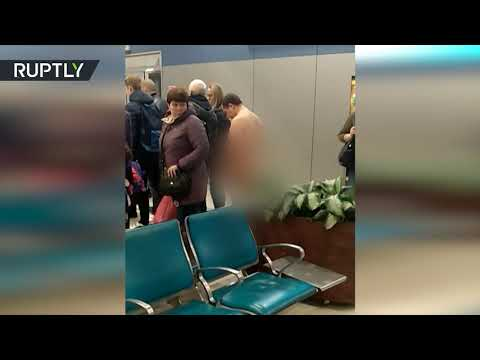 NAKED man tries to board plane in Moscow airport