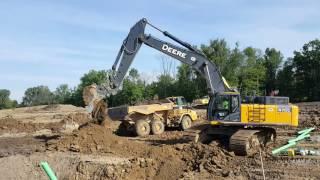 John Deere 470G LC Excavator Digging Sanitary Trench