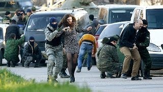 Russian forces storm Ukraine's Crimea bases