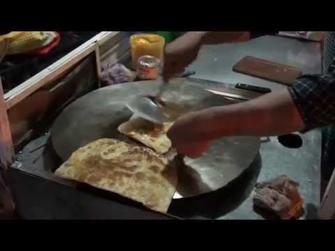 Making banana pancakes in a Lao street market