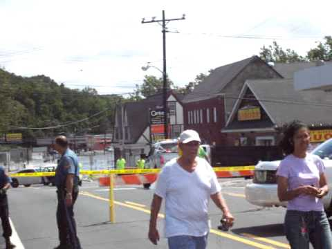 Pompton Lakes, NJ, Police Keep Onlookers Away From The Pompton Falls Dam.