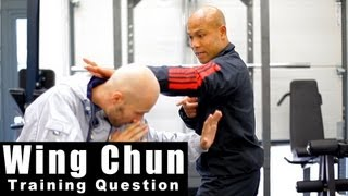 Wing Chun Training - wing chun use only one hand to defend? Q4