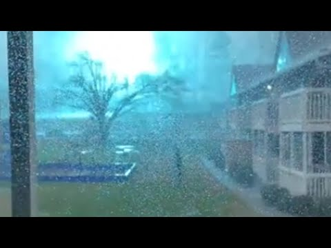 She takes out her camera to film the storm, captures this instead