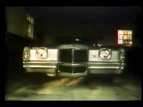 1971 Pontiac Grand Prix Commercial with1936 Cord 810 in  background