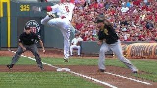 Hamilton avoids the tag, reaches on bunt hit