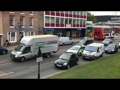 Police car fighting through traffic in Canterbury