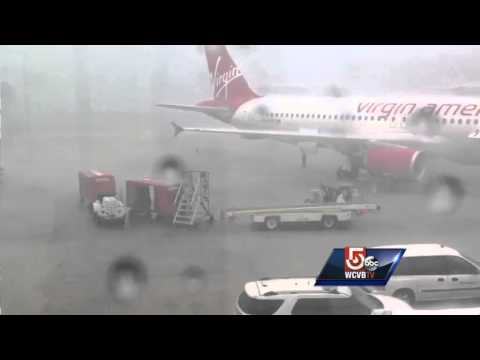 Heavy rain, strong winds caught on tape at Logan