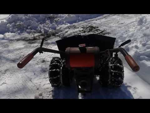 Gravely LI with V plow.  AKA the Gravely Snow-mole-bile