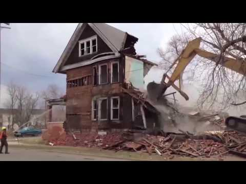 MAN Vs MACHINE. Recycling a house is better than mulching it with an excavator.