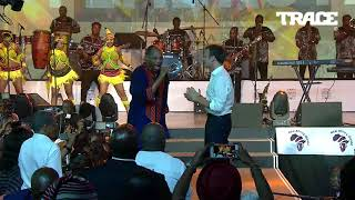 femi kuti dancing with president of france emmanuel macron