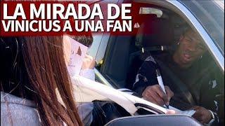 La triple mirada de Vinicius Jr. a una fan mientras le firmaba la camiseta en Valdebebas | Diario AS