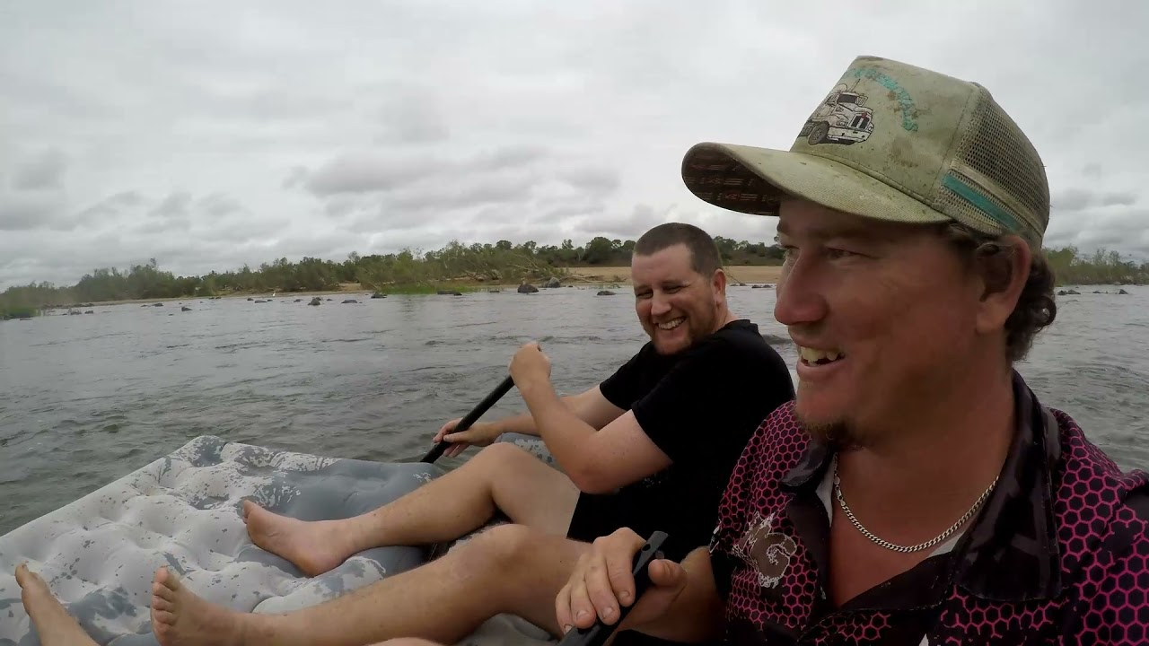 Floating down the river on a Kmart couch!