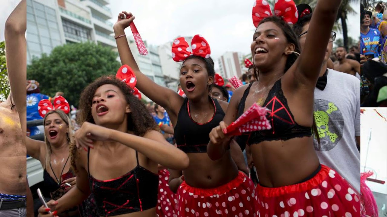 Topless revellers and sizzling samba dancers take to Rio streets as they gear up for Carnival
