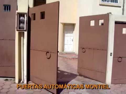 Puerta abatible con pistones una hoja hacia adentro y for Puertas que abren hacia afuera
