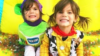 Twins Kate & Lilly PLAY dress up as Woody & Buzz from TOY STORY on a GIANT ORBEEZ Water Slide!!