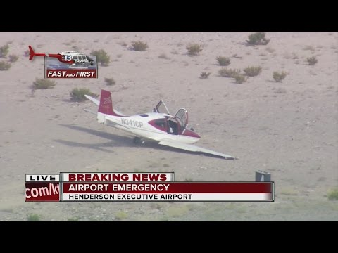 Plane lands short of runway at Henderson Executive Airport