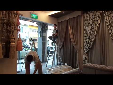 Installing window blinds for a curtain showroom