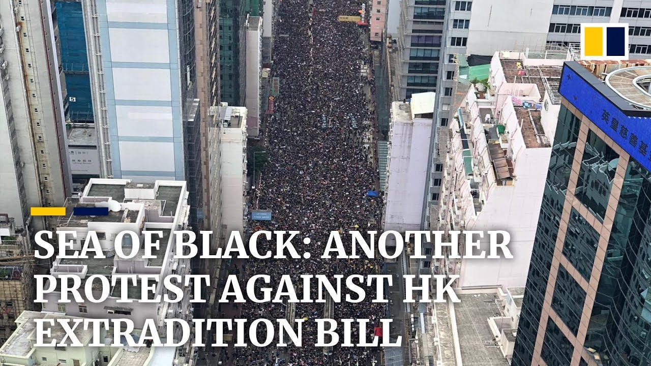Hong Kong protesters march against extradition bill for second straight Sunday - YouTube