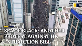 Hong Kong protesters march against extradition bill for second straight Sunday