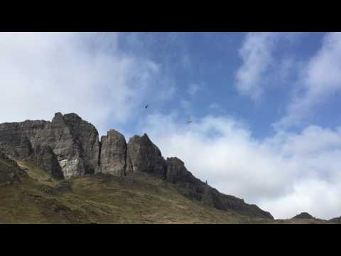 Harry Styles dangling from a helicopter over the Old Man of Storr, on Skye