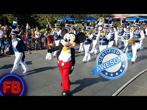 Marching with Mickey down Main Street + Tarzans Treehouse and shopping