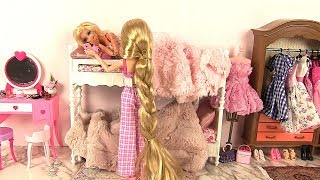 Barbie and Rapunzel wake up on their bunk beds for their morning ro...