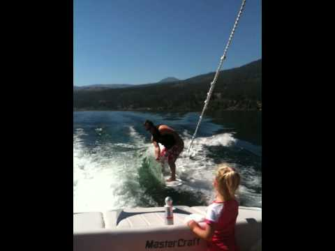 Dave Vass surfing it up behind the boat