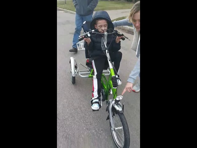 Boy with cerebral palsy rides bike for the first time