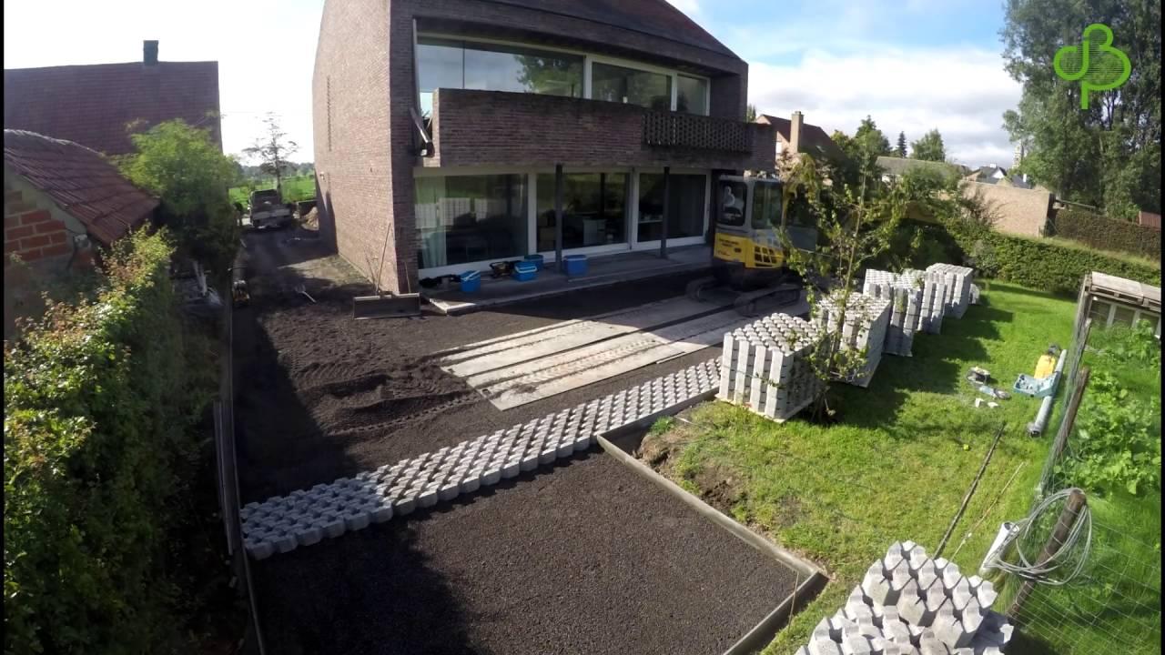Jan belaen aanleg oprit in betonnen grastegels op lava for Aanleg oprit