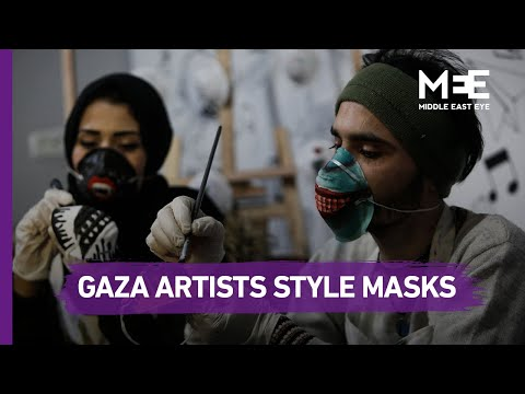 Palestinian artists paint on masks amid coronavirus outbreak