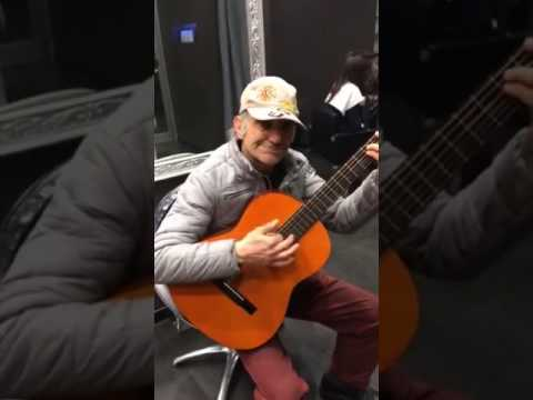 Talented Old man play western spaghetti with guitar and his mouth