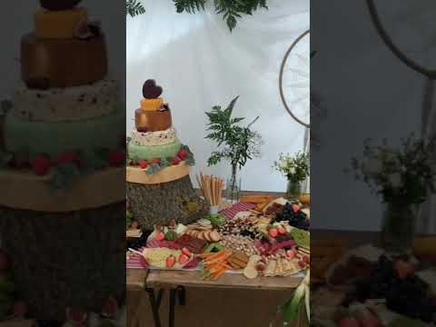 Wedding cheese cake proudly towering above Grazing table for Wedding reception.