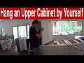 How to install an upper kitchen cabinet by yourself
