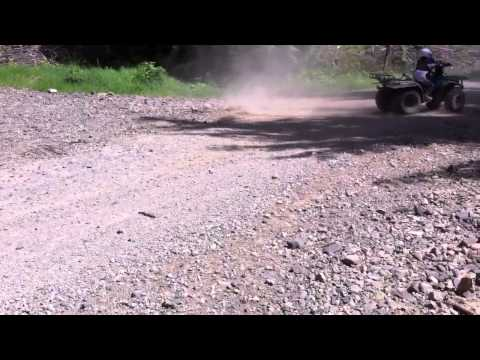 My 10 yr old son doin donuts on his SUZUKI lt250 quadrunner
