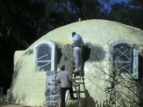 Dome home encapsulating exterior with closed cell foam for Foam concrete house construction