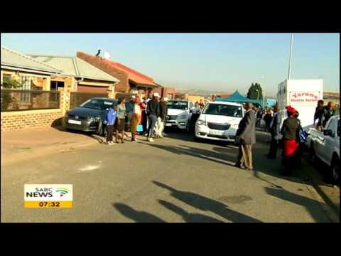 Mandoza's coffin leaves his home