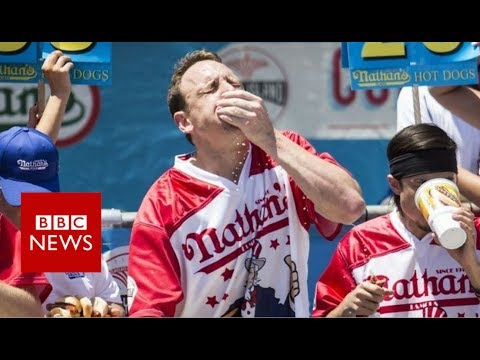 Hot Dog Eating Contest: Man eats 72 hot dogs in 10 minutes - BBC News