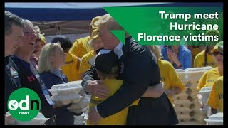 Trump gives hugs and handouts to Hurricane Florence victims