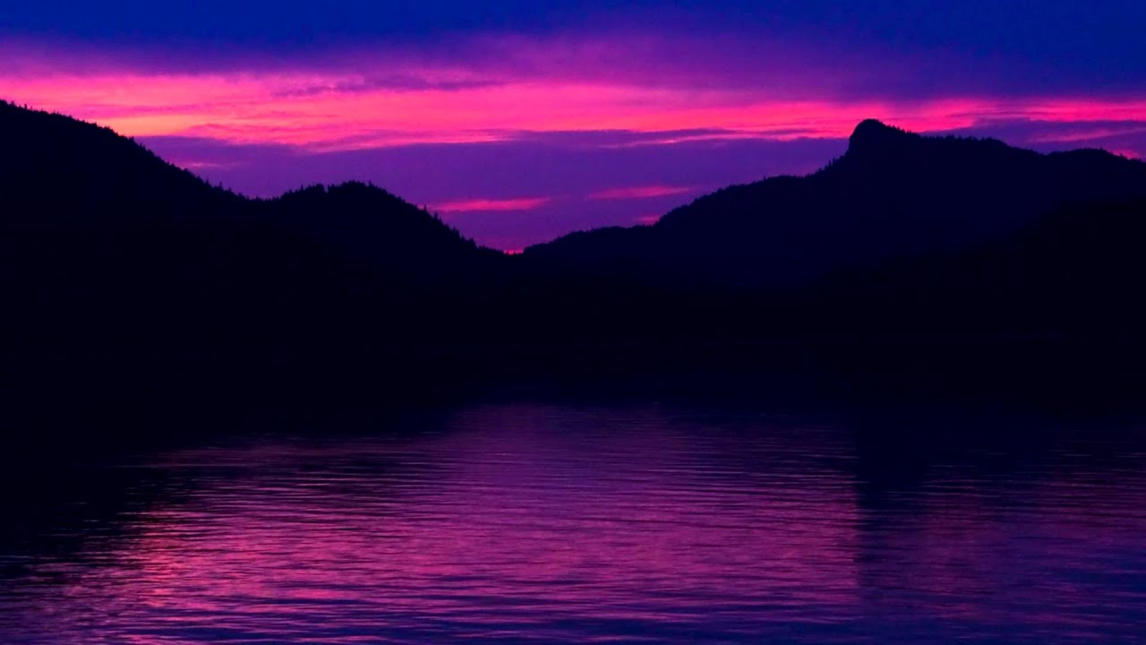 Fall Season Wallpaper Free Time Lapse Of A Pink Sunset Behind The Silhouette Of