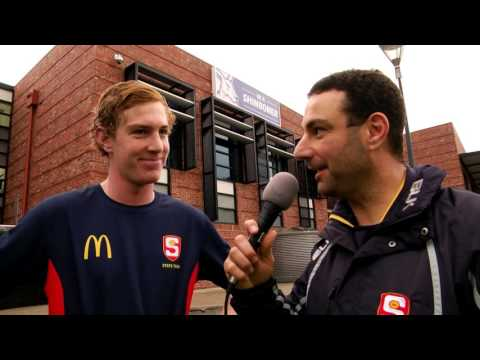 SANFL Talent Pathways Manager Julian Farkas chats to McDonald's SA U18 defender Harry Petty