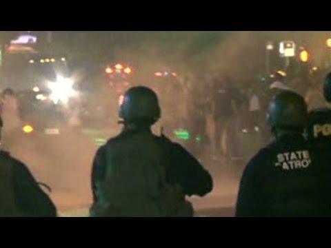 Protesters defy Ferguson curfew