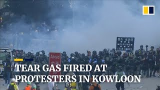 Police fire tear gas to disperse hundreds of anti-government protesters in Kowloon