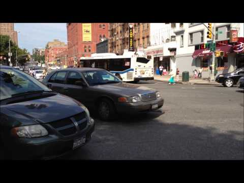 NYPD UNMARKED POLICE CRUISER RESPONDING AT 125TH ST. & AMSTERDAM AVE. IN HARLEM, NEW YORK CITY.