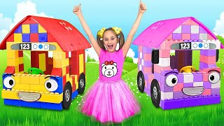 Sasha playing with Colored Blocks Toy Buses thumbnail