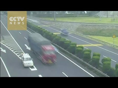 Watch: Crazy driver drives in reverse on highway